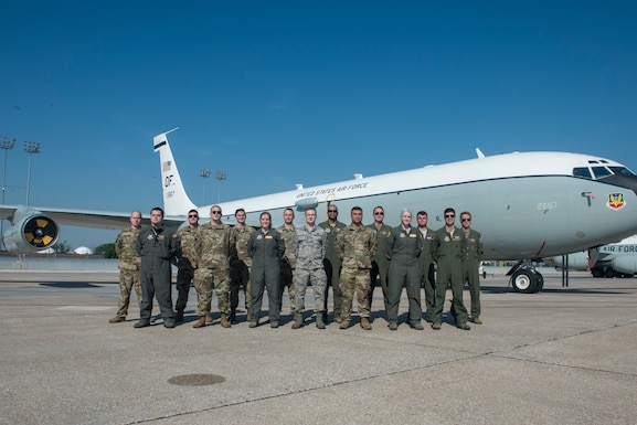 Photo of award winning glass titan team in front of a WC-135W Constant Phoenix.