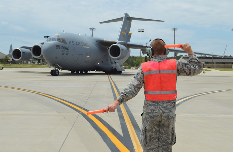 A C-17 Globemaster III aircrew gets ready for a training flight at Pope Field. The aircraft from Joint Base Charleston allowed Pope aircrew to meet training requirements despite COVID-19 restrictions