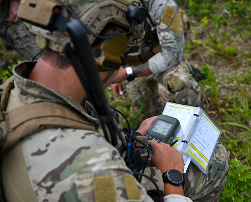 A U.S. Air Force joint terminal attack controller assigned to the 320th Special Tactics Squadron fills in information for a 9-line at Draughon Range, near Misawa Air Base, Japan, June 15, 2020. A 9-line is a standardized format in which a JTAC gives targeting information to aircraft pilots. Brandt and other JTACS from the 320th STS came to Draughon Range to maintain their currency as combat controllers. (U.S. Air Force photo by Tech. Sgt. Timothy Moore)