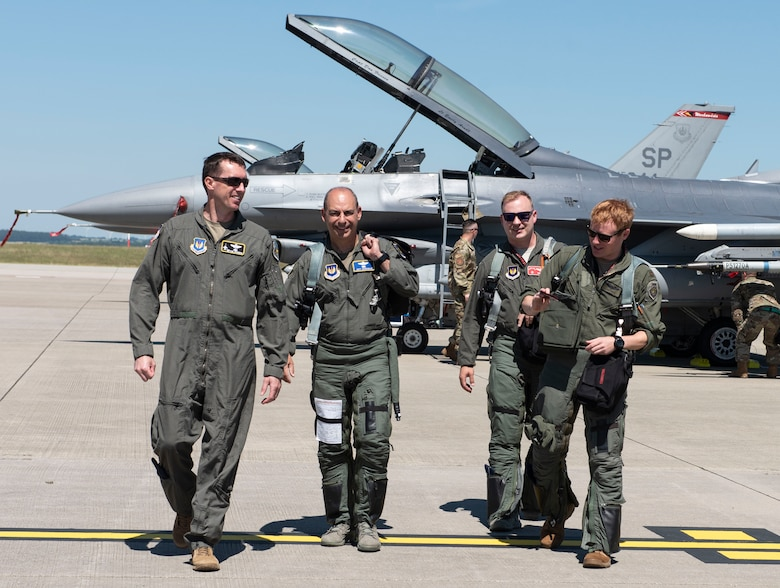 Lt. Col. David Epperson, from left, 52nd Fighter Wing commander, Gen. Jeff Harrigian, U.S. Air Forces in Europe and Air Forces Africa commander, Capt. Daniel Cook, 480th Fighter Squadron pilot, and Maj. Sean Foote, 480th FS pilot, walk towards the Agile Combat Employment exercise setup at Spangdahlem Air Base, Germany, June 26, 2020. Exercising elements of ACE enables USAFE-AFAFRICA to operate from locations with varying levels of capacity and support, ensuring Airmen and aircrews are postured to deliver lethal combat power across the spectrum of military operations. (U.S. Air Force photo by Senior Airman Melody W. Howley)
