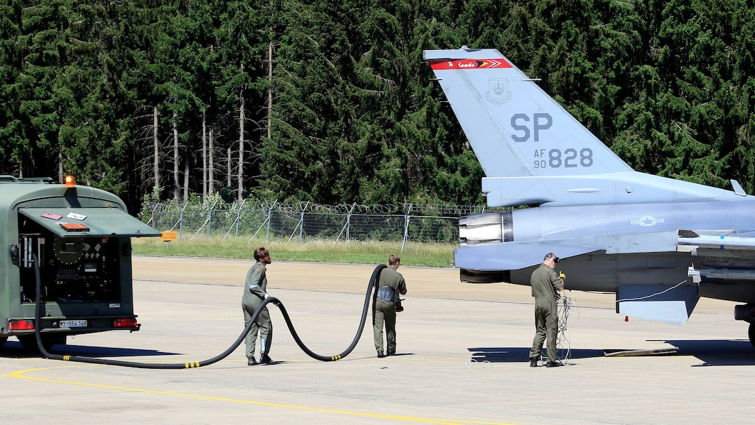 Members from Luftwaffe's 33rd Tactical Air Force Wing refuel a U.S. Air Force F-16 Fighting Falcon assigned to the 52nd Fighter Wing, Spangdahlem Air Base, at Büchel Air Base, Germany, June 25, 2020. European partners play a crucial part in Agile Combat Employment exercises, and aid in the ability to deter, defend, and win real world situations. (Photo courtesy of Büchel Air Base Public Affairs)