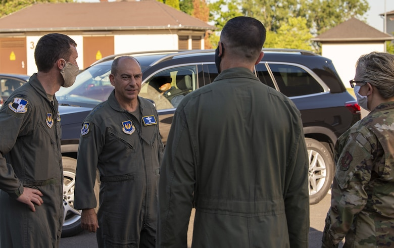 52nd Fighter Wing leadership greets Gen. Jeff Harrigian, second from left, U.S. Air Forces in Europe and Air Forces Africa commander, before the start of an Agile Combat Employment exercise at Spangdahlem Air Base, Germany, June 25, 2020. Engagement incorporating ACE concepts in less-than-optimal environments improves interoperability among forces and helps allies and partners increase their capabilities. (U.S. Air Force photo by Senior Airman Branden Rae)