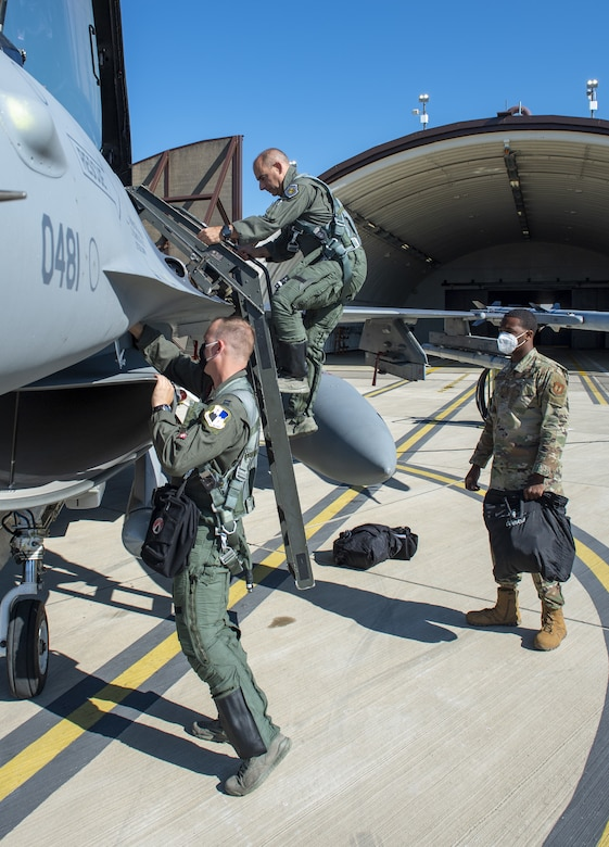Gen. Jeff Harrigian, center, U.S. Air Forces in Europe and Air Forces Africa commander, Capt. Daniel Cook, left, 480th Fighter Squadron pilot, and Airman 1st Class Tyrek Montgomery, 52nd Aircraft Maintenance Squadron assistant dedicated crew chief, complete pre-flight procedures before participating in an Agile Combat Employment exercise on the flight line at Spangdahlem Air Base, Germany, June 25, 2020. ACE allows the U.S. to deter adversaries and win across the spectrum of conflict. (U.S. Air Force photo by Senior Airman Branden Rae)