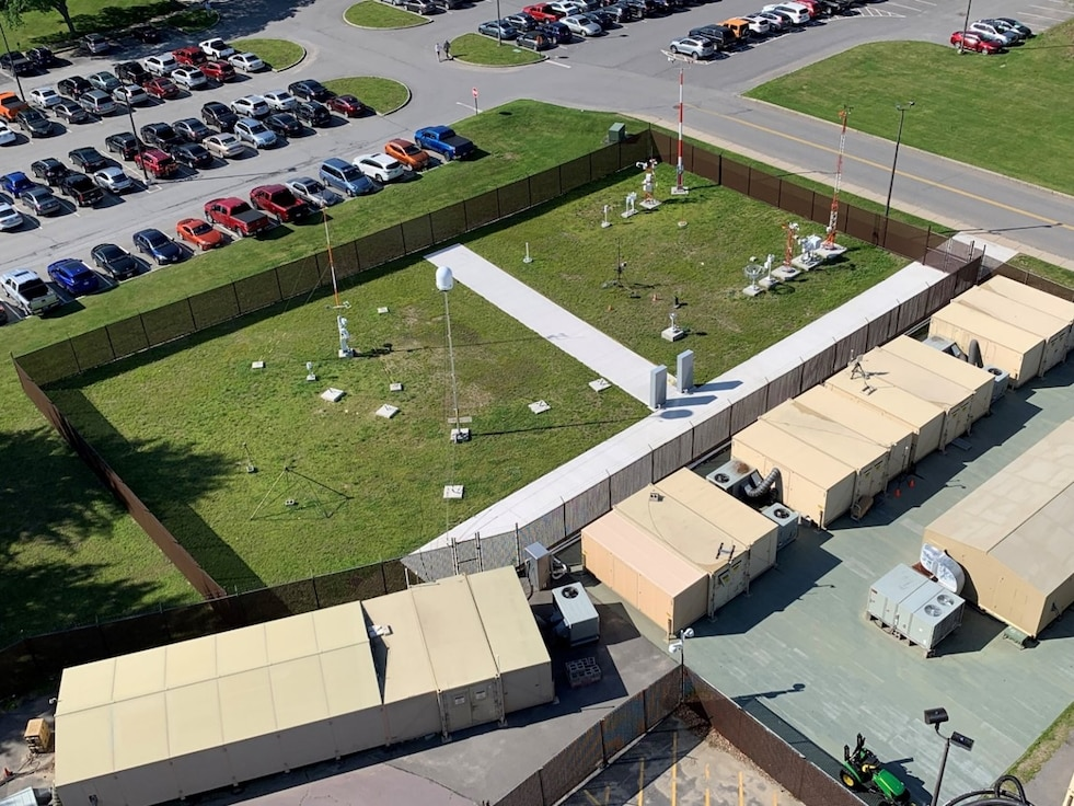 "An aerial view of fixed based weather systems and a portable Doppler radar system at the Weather Engineering Facility at Hanscom Air Force Base, Mass. A team at Hanscom recently worked innovatively with the 46th Test Squadron, Eglin AFB, Fla., to become ""remote hands"" using the WEF to ensure testing necessary to keep fixed based weather systems operational would continue, despite the ongoing global pandemic. (U.S. Air Force photo by Steve O'Neil)"