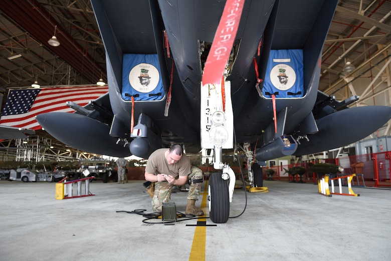 A Liberty Wing Airman assigned to the 492nd Fighter Squadron Aircraft Maintenance Unit inspects an F-15E Strike Eagle at Royal Air Force Lakenheath, England, June 26, 2020. Load crew competitions help Airmen test their speed and accuracy while focusing on safety and efficiency in a controlled environment. (U.S. Air Force photo by Airman 1st Class Rhonda Smith)
