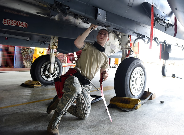 A Liberty Wing Airman assigned to the 492nd Fighter Squadron Aircraft Maintenance Unit prepares to load munitions on an F-15E Strike Eagle at Royal Air Force Lakenheath, England, June 26, 2020. Load crew competitions help Airmen test their speed and accuracy while focusing on safety and efficiency in a controlled environment. (U.S. Air Force photo by Airman 1st Class Rhonda Smith)