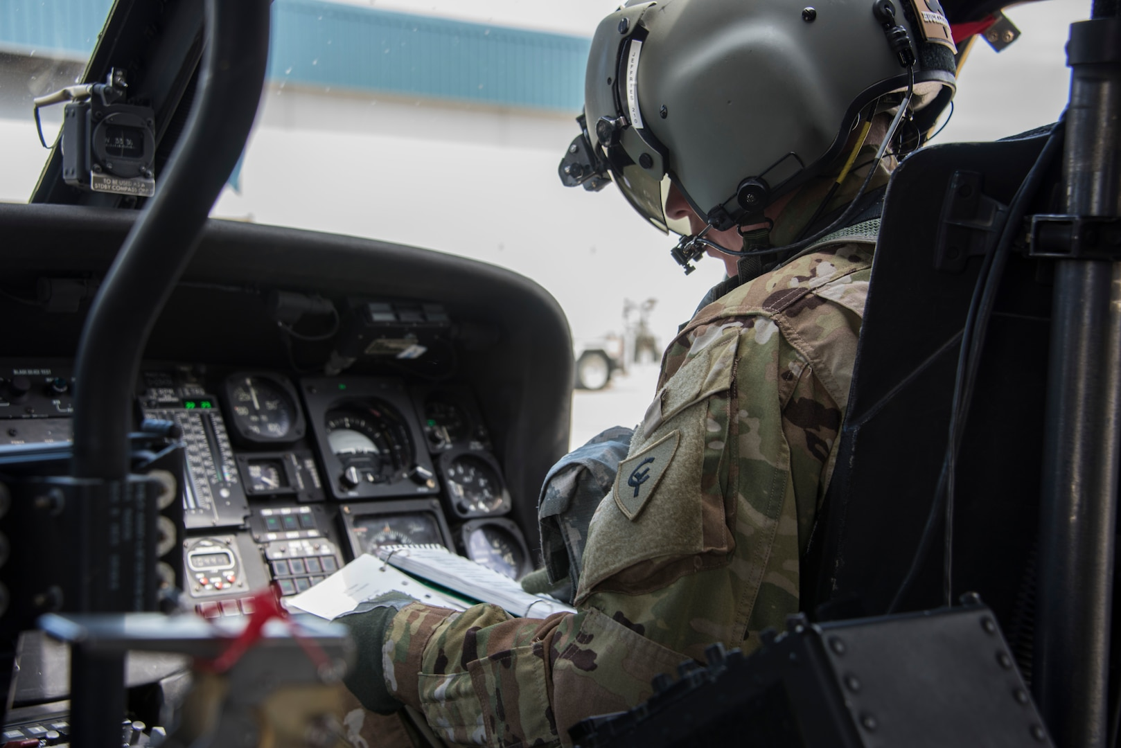 An Indiana National Guard UH-60 Black Hawk pilot conducts preflight checks before a combat search-and-rescue training exercise in Miami County, Indiana, June 18, 2020. The mock scenario utilized a UH-60 Black Hawk helicopter from the Gary Army Aviation Support Facility and multiple A-10C Thunderbolt II fighter jets from the 122nd Fighter Wing, Fort Wayne, to retrieve personnel from a downed aircraft inside hostile territory.