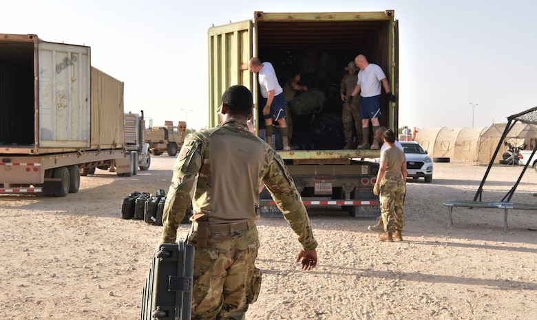 The 378th Expeditionary Logistics Readiness Squadron moves bags at Prince Sultan Air  Base, Kingdom of Saudi Arabia, June 28, 2020.
