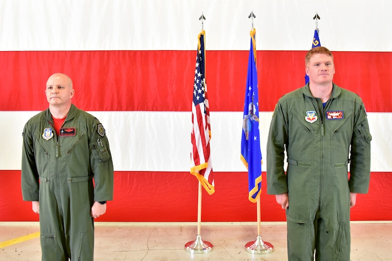 """Col. Joshua Padgett, 301st Fighter Wing Operations Group commander, and Maj. Ryan """"Rojo"""" Busbey, 24th Fighter Squadron commander, stand during the 24th FS assumption of command ceremony, June 26, 2020, at Naval Air Station Joint Reserve Base Fort Worth, Texas. Busbey is responsible for leading a team of 190 active duty Airmen consisting F-16 pilots, maintainers, medical, communications, and administrative support personnel. (U.S. Air Force photo by Staff Sgt. Randall Moose)"""