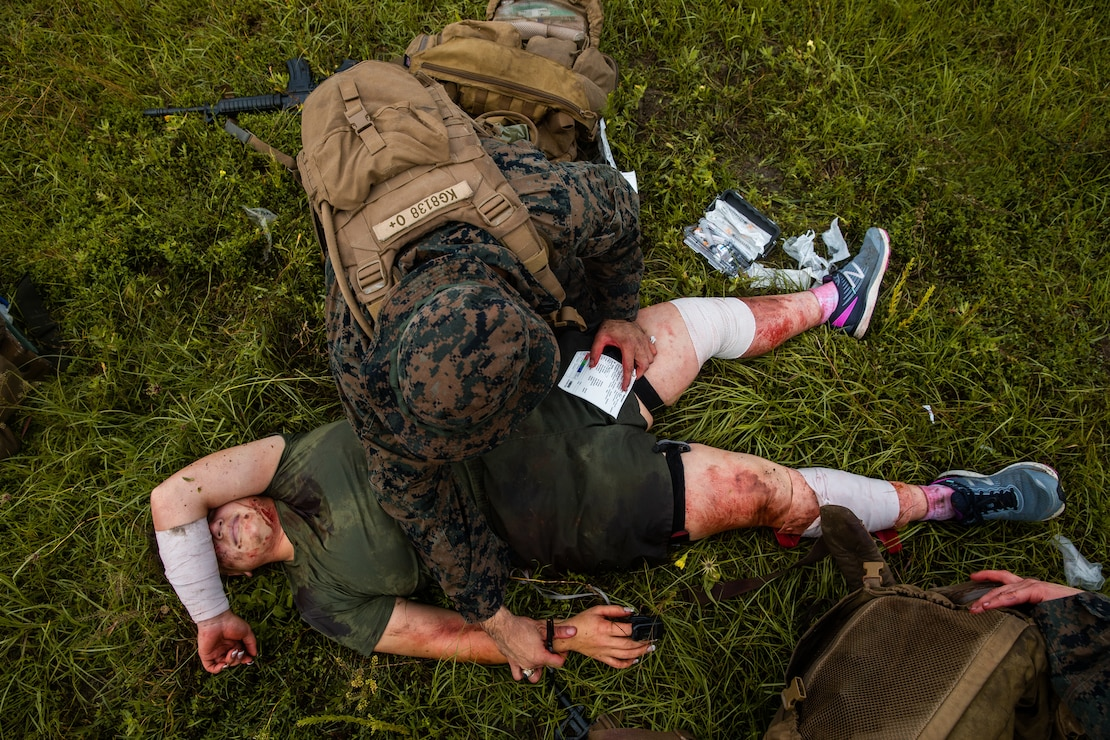 A U.S. Navy corpsman treats a patient during a 10-mile trauma run at Camp Lejeune, N.C, June 17.
