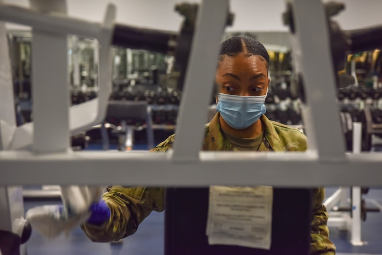 Staff Sgt. Rondashia Singleton, NCO in charge of the fitness center assigned to the 628th Force Support Squadron, deep cleans a piece of equipment in the Airbase Fitness Center at Joint Base Charleston, S.C., June 26, 2020. Members of the 628th FSS use sanitizing solution on all surfaces that people touch on a regular basis and have created parameters to reduce the spread of COVID-19 to ensure that JB Charleston continues to restore readiness.