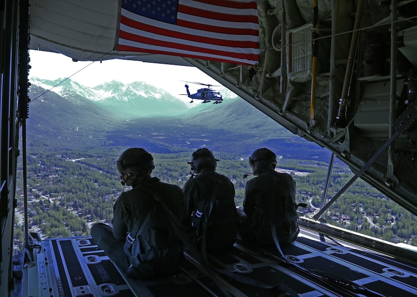 Alaska Air National Guard Loadmasters aboard a HC-130J Combat King II observe an HH-60 Pave Hawk as it prepares for an aerial refueling. The 176th Wing conducted the first of the flyovers for Alaska. The Salute to Alaska flyovers were an approved training mission and part of the Air Force Salutes initiative designed to show appreciation to the heroes around the world battling the pandemic, and to lift morale in communities across America. (U.S. Navy photo by Mass Communication Specialist 3rd Class Victoria Granado/Released)