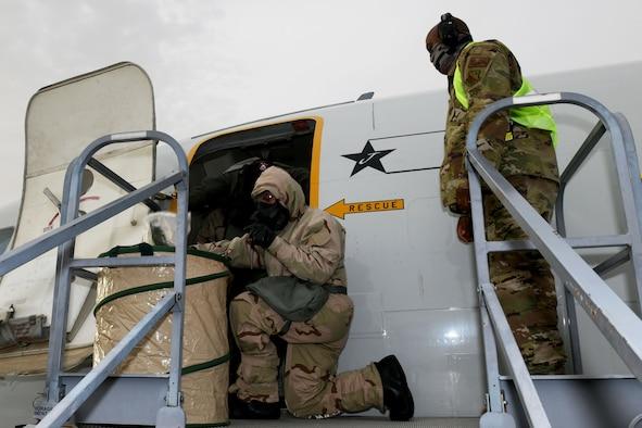 Photo shows an Airmen disposing of gear.