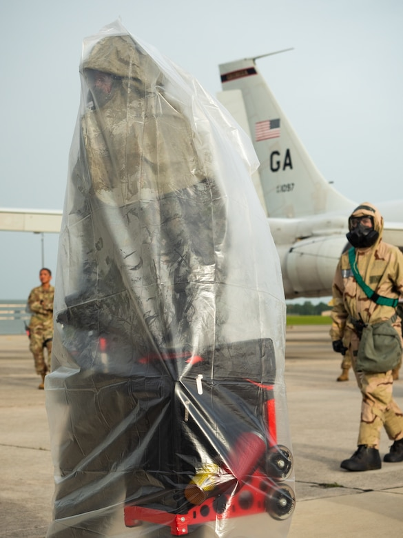 Photo shows an Airman in chem gear.