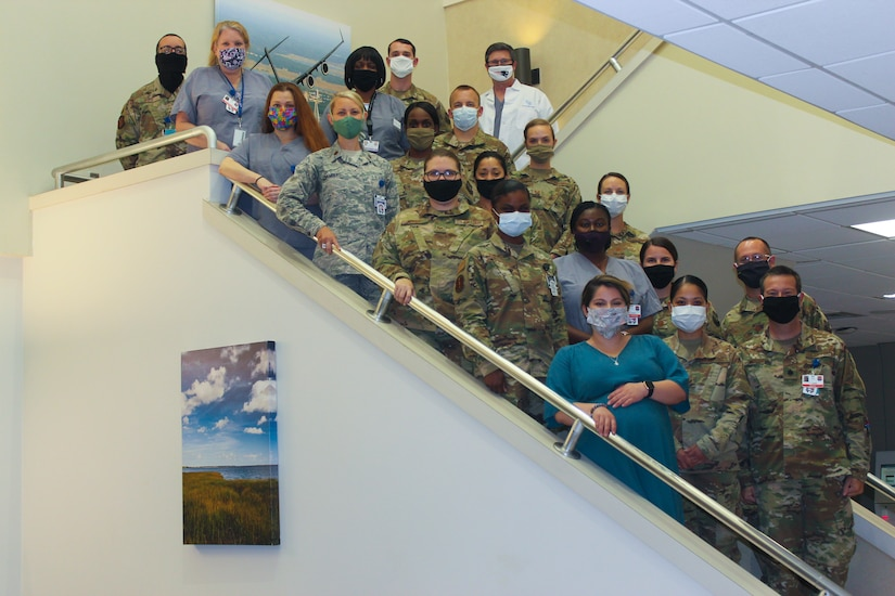 Dental clinic personnel from the 628th Operational Medical Readiness Squadron pose for a photo at Joint Base Charleston, S.C. The dental clinic is open for dental emergencies and deployment exams and has recently started taking annual exams. Dental clinic personnel are protecting their patients and themselves by regularly cleaning surfaces, wearing masks and gloves, reducing the number of patients they see, practicing physical distancing whenever possible and having patients use pretreatment mouth rinse.