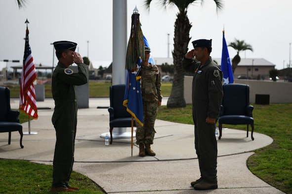 U.S. Air Force Col. Greg Moseley assumes command of the 325th Fighter Wing from U.S. Air Force Maj. Gen. Chad Franks, Ninth Air Force commander, during a change of command ceremony at Tyndall Air Force Base, Florida, June 26, 2020. As the 325th FW commander, Moseley will oversee F-22 Raptor pilot training as well as the continued rebuild of the base following the damage done by Hurricane Michael in 2018. (U.S. Air Force photo by Tech. Sgt. Clayton Lenhardt)