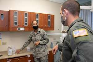 U.S. Air Force Tech. Sgt. Vanessa Powell-Davis, left, 60th Dental Squadron noncommissioned officer in charge of infection control, explains the process of testing dental equipment waterlines for the presence of bacteria to Col. Zachery Jiron, 60th Air Mobility Wing vice commander, during Leadership Rounds June 26, 2020, at David Grant USAF Medical Center, Travis Air Force Base, California. The Leadership Rounds program provides 60th AMW leadership an opportunity to interact with Airmen and get a detailed view of each mission performed at Travis AFB.  (U.S. Air Force photo by Heide Couch)