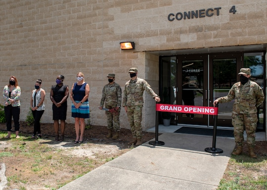 Members of Team Seymour gather for the Connect 4 ribbon cutting ceremony at Seymour Johnson Air Force Base, North Carolina, June 30, 2020. Connect 4 houses the Airman's Attic, Home Front Room Revival, Cinderella's Closet and a food pantry. (U.S. Air Force photo by Airman 1st Class Kimberly Barrera)