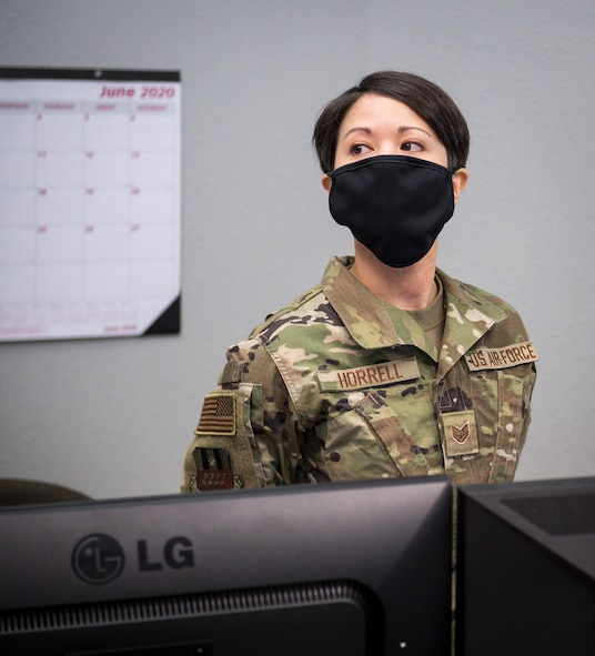 Staff Sgt. Dylana Horrell, 2nd Comptroller Squadron financial operations supervisor, briefs Col. Michael Miller, 2nd Bomb Wing commander, on her role in the new River's Edge Welcome Center at Barksdale Air Force Base, La., June 29, 2020.