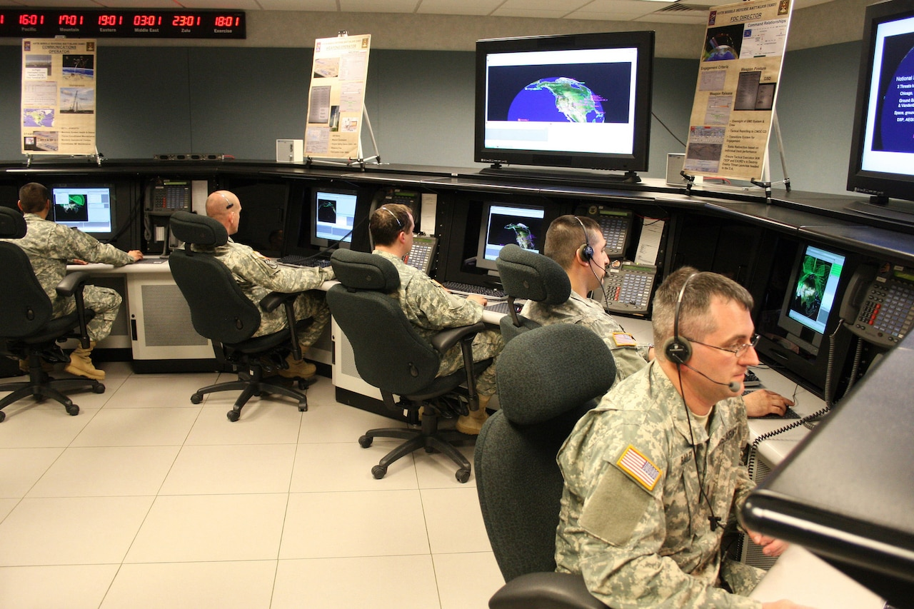 Soldiers man consoles in operations room.