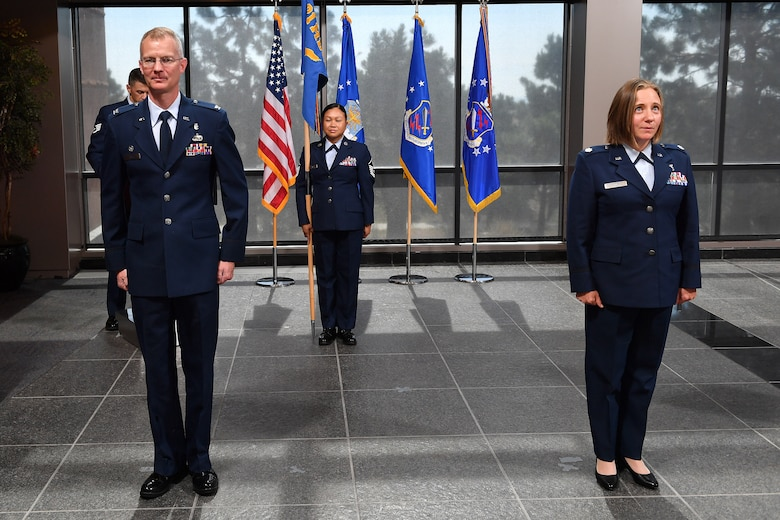 Col. Patrick Pohle, 21st Medical Group commander, left, and Lt. Col. Joanna Jaminska, incoming 21st Medical Squadron commander, participate in a change of command ceremony June 29, 2020, at Schriever Air Force Base, Colorado. Jaminska took command of the 21st MDS, which is responsible for providing medical services to Schriever Airmen. Jaminska is coming from Maxwell AFB, Alabama, where she was a student in the U.S. Air Force Air War College.  (U.S. Air Force photo by Dennis Rogers)