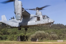 Marines with Combat Logistics Battalion (CLB) 31, 31st Marine Expeditionary Unit (MEU), attach a tire load to an MV22B Osprey tiltrotor aircraft with Marine Medium Tiltrotor Squadron 262 (Reinforced) during a helicopter support team (HST) training exercise at Kin Blue, Okinawa, Japan, June 18, 2020. The HST training was conducted to increase proficiencies in logistics tasks and enhance the ability to execute external lifts.