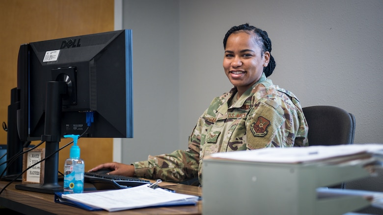 Senior Airman Destiny Jarvis, 2nd Logistics Readiness Squadron traffic management office personal property counselor, poses for a photo in the new River's Edge Welcome Center at Barksdale Air Force Base, La., June 29, 2020.