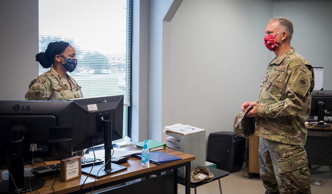 Senior Airman Destiny Jarvis, 2nd Logistics Readiness Squadron traffic management office personal property counselor, briefs Col. Michael Miller, 2nd Bomb Wing commander, on her role in the new River's Edge Welcome Center  at Barksdale Air Force Base, La., June 29, 2020