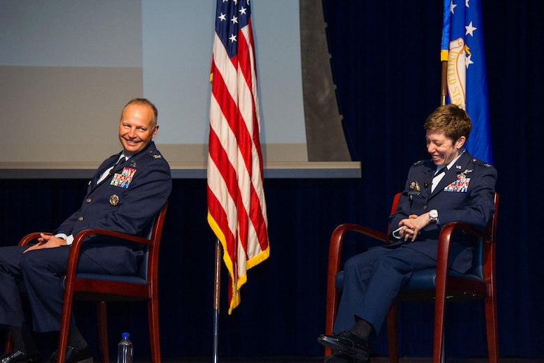 Outgoing commander Col. Chad Hartman (left) shares a laugh with incoming commander Col. Katharine Barber (right) during the Air Force Technical Applications Center's Change of Command ceremony at Patrick AFB, Fla., June 30, 2020.  (U.S. Air Force photo by Amanda Ryrholm)