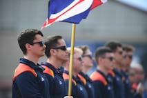 Royal Marines from the United Kingdom (UK) stand at attention during the playing of the UK National Anthem at the opening ceremony of the 2020 Marine Corps Trials on Marine Corps Base Camp Pendleton, California, Feb. 28. The Marine Corps Trials promotes rehabilitation through adaptive sports participation for Recovering Service Members and veterans all over the world. (Official U.S. Marine Corps photo by Lance Corporal Garrett Gillespie)
