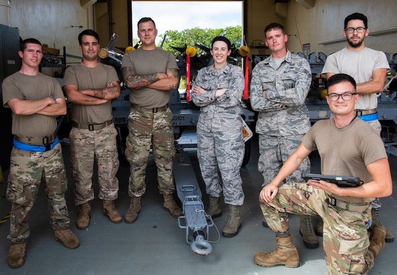 U.S. Air Force 2nd Lt. Megan Barrick, 36th Munitions Squadron (MUNS), Flight Commander, stands with her Airmen, Feb. 27 2020, at Andersen Air Force Base, Guam.