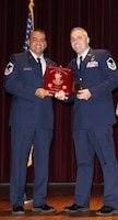 Office of Special Investigations Special Agent Nicholas Linsalata accepts the John L. Levitow Award from Senior Master Sgt. Jason A. Ramon, Sheppard Air Force Base, Texas, Noncommissioned Officer Academy Director of Education, during ceremonies Feb. 21, 2020, for the largest NCOA graduating class in history, 304 students. (Sheppard NCOA photo)