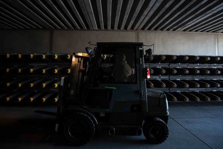 U.S. Air Force Airman 1st Class Matt Amato, 86th Munitions Squadron munitions stockpile management technician, operates a forklift while moving crates of munitions into a storage facility at Ramstein Air Base, Germany, Feb. 6, 2020. Approximately 200 containers have been downloaded and stored in the MUNS area to further strengthen the firepower that can be delivered to the three combatant commands in the area of operation.