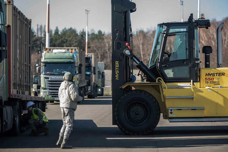U.S. Airmen assigned to the 86th Munitions Squadron unload containers of inert munitions inside the 86th MUNS compound at Ramstein Air Base, Germany, Feb. 6, 2020. The 86th MUNS received truckloads of munitions daily in the span of one week. (U.S. Air Force photo by Staff Sgt. Devin Nothstine)
