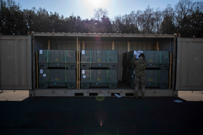 A U.S. Airman assigned to the 86th Munitions Squadron ensures the proper transport of serial numbered containers by verifying and accounting for them inside the 86th MUNS compound at Ramstein Air Base, Germany, Feb. 6, 2020. The 86th MUNS received their largest shipment of munitions in 20 years. (U.S. Air Force photo by Staff Sgt. Devin Nothstine)