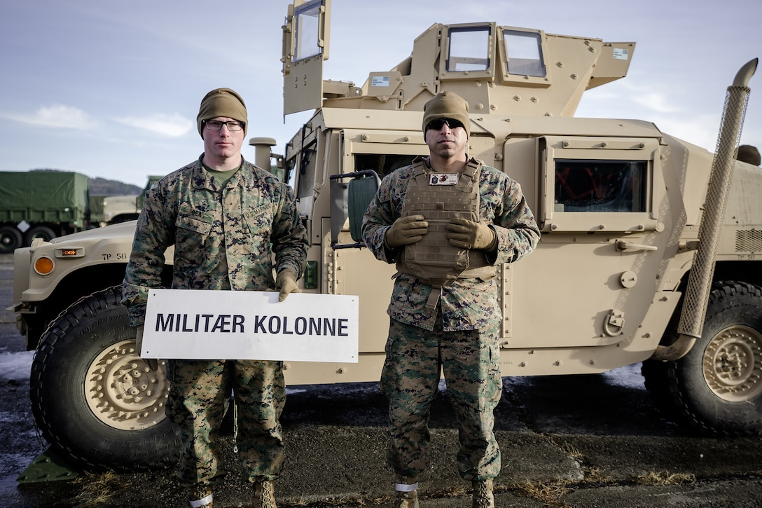 U.S. Marines with Combat Logistics Battalion 451, Combat Logistics Regiment 45, 4th Marine Logistics Group, Marine Forces Reserve, pose for a photo before doing a convoy from Marine Corps Prepositioning Program-Norway caves to Værnes Garrison near Trondheim, Norway, Feb. 14, 2020. MCPP-N gear was later transported from Orkanger Port to Bogen Port in preparation for Exercise Cold Response. Cold Response is a Norwegian-led exercise designed to enhance military capabilities and allied cooperation in high-intensity warfighting in a challenging arctic environment. (U.S. Marine Corps photo by Sgt. Devin J. Andrews)