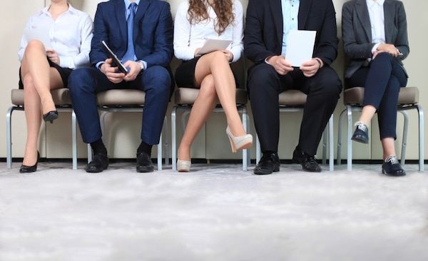 four people waiting for a job interview