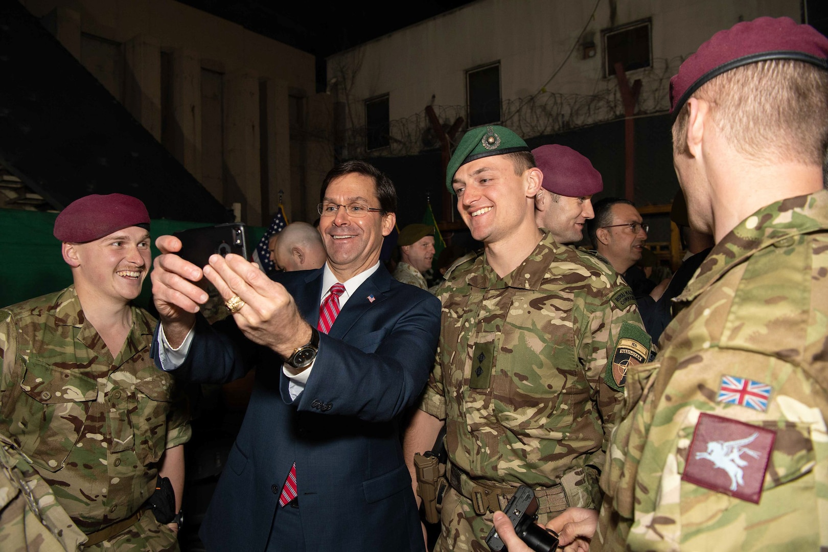 Defense Secretary Dr. Mark T. Esper takes a photo while meeting with coalition service members in Kabul, Afghanistan, Feb. 29, 2020.