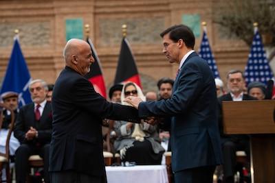 Defense Secretary Dr. Mark T. Esper shakes hands with Afghan President Ashraf Ghani in Kabul, Afghanistan, Feb. 29, 2020.