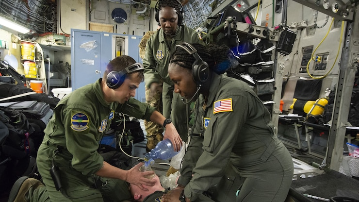 Airmen receive in-flight medical training while on-board a C-17 Globemaster III.