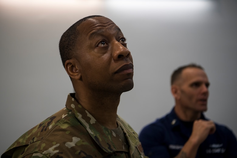 Chief Master Sgt. Cedric Nettles, 628th Mission Support Group superintendent, looks at a C-17 Globemaster III engine during a tour at Joint Base Charleston, S.C., Feb. 27, 2020.