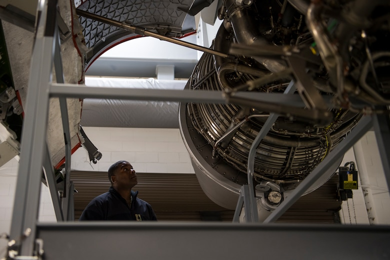 Command Senior Chief Petty Officer Jaz Davis, Citadel ROTC command senior enlisted leader, looks at a C-17 Globemaster III engine during a tour at Joint Base Charleston, S.C., Feb. 27, 2020.