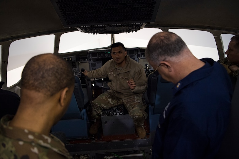 Tech. Sgt. Julius Caluya, 373rd Training Squadron Detachment 5 instructor, gives a tour of a C-17 Globemaster III simulator at Joint Base Charleston, S.C., Feb. 27, 2020.