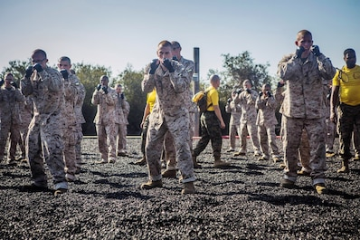 Recruits with Golf Company, 2nd Recruit Training Battalion, participate in a Marine Corps Martial Arts Program session at Marine Corps Recruit Depot San Diego, Feb. 24, 2020.