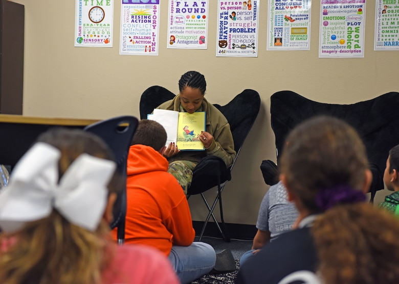 "U.S. Air Force Senior Airman Brianna Cash, 17th Comptroller Squadron financial analyst, shows a page from ""Hunches in Bunches"" to a fifth grade class at McGill Elementary School in San Angelo, Texas, Feb. 27, 2020. Older students enjoy the readings because it is a break from the fast tempo of school and they have a chance to interact with someone that may have the job they want. (U.S. Air Force photo by Airman 1st Class Ethan Sherwood)"