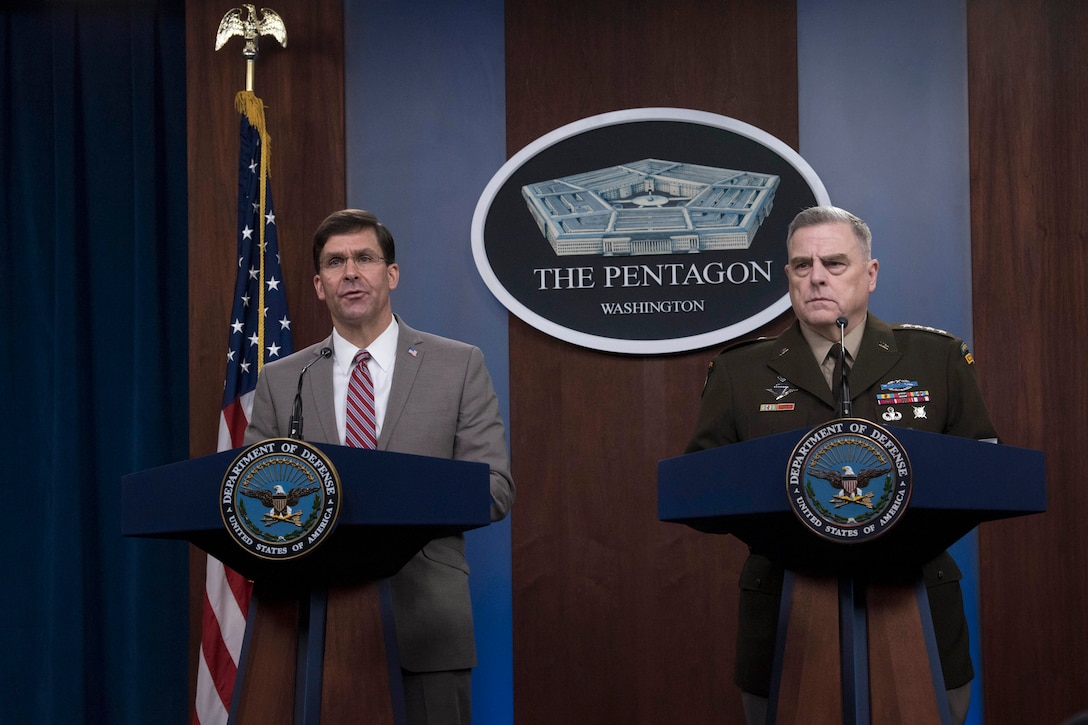 Defense Secretary Dr. Mark T. Esper and Army Gen. Mark A. Milley stand next to each other at lecterns.