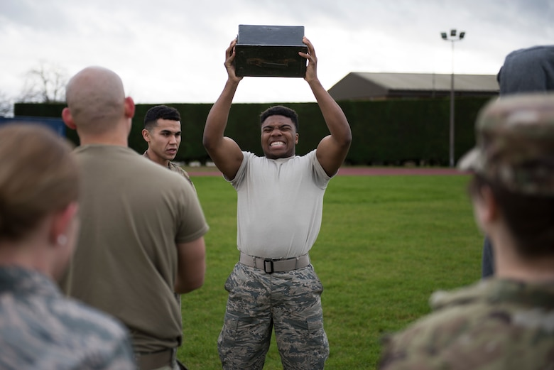 U.S. Air Force Airman 1st Class Troy Glasper, 423rd Force Support Squadron postal clerk, lifts an ammunition can during a practice Marine Corps Combat Fitness Test at the Joint Immersion Day at RAF Alconbury, England, Feb. 20, 2020. Joint Immersion Day was an opportunity for Air Force, Army, Marines and Navy, to come together to learn about each branch's history, culture, structure and evaluations, in order to be aware of our similarities, differences, and needs in a joint environment. (U.S. Air Force photo by Airman 1st Class Jennifer Zima)