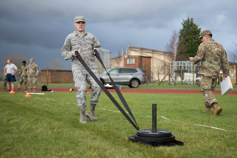 U.S. Air Force Staff Sgt. Stacy Strange, U.S. Africa Command Directorate for Intelligence at RAF Molesworth imagery analyst, pulls a sled with weights in the Sprint-Drag-Carry portion of a practice Army Combat Fitness Test at the Joint Immersion Day at RAF Alconbury, England, Feb. 20, 2020. Joint Immersion Day was an opportunity for Air Force, Army, Marines and Navy, to come together to learn about each branch's history, culture, structure and evaluations, in order to be aware of our similarities, differences, and needs in a joint environment. (U.S. Air Force photo by Airman 1st Class Jennifer Zima)