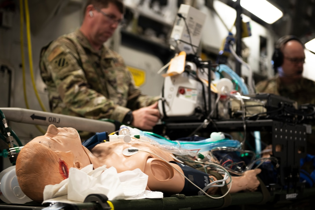 A U.S. Air Force CCATT (Critical Care Air Transport Team) crew assigned to multiple Air National Guard units provide in-flight medical care to a trauma training manikin on board of a C-17 Globemaster during Patriot South 2020 at the Gulfport Combat Readiness Training Center in Gulfport, Miss., Feb. 27, 2020.  PATRIOT is a Domestic Operations disaster-response training exercise conducted by National Guard units working with federal, state and local emergency management agencies and first responders. (U.S. Air National Guard photo by Technical Sgt. L. Roland Sturm)