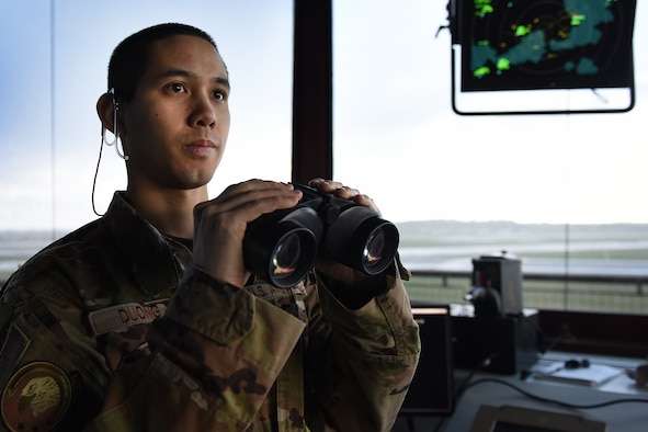 Airman 1st Class Howie Duong, 48th Operational Support Squadron air traffic controller, watches for aircraft preparing to depart at Royal Air Force Lakenheath, England, Feb. 25, 2020. Air traffic controllers are responsible for managing the flow of aircraft through all aspects of their flight and ensuring the safety and efficiency of air traffic on the ground and in the air. (U.S. Air Force photo by Airman 1st Class Jessi Monte)